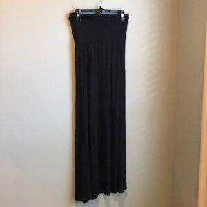 Long black knit skirt. Wide fold-over waist